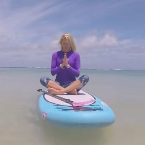 Lady doing yoga on a paddle board