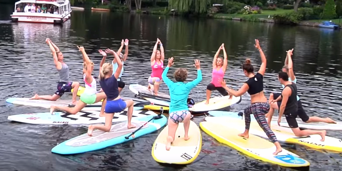 A yoga stand up paddle board class